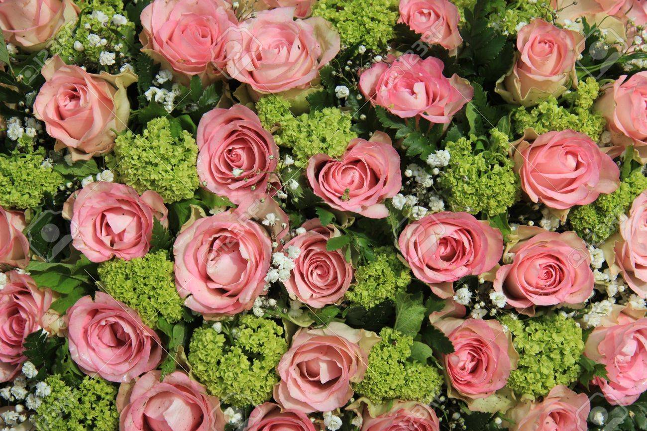 Small Pink Roses And White Gypsophila In A Wedding Centerpiece Stock