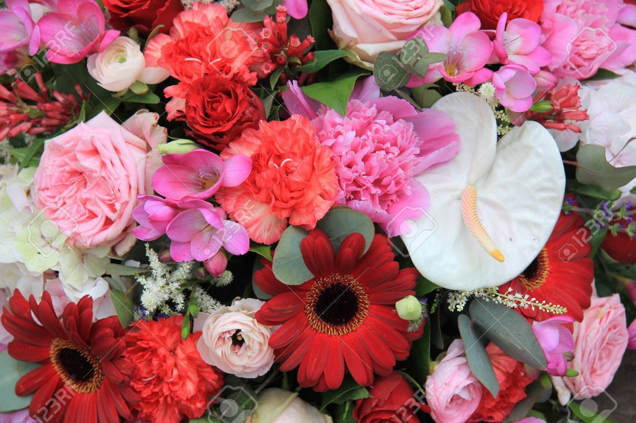 Flower arrangement with various flowers in different shades of flower arrangement with various flowers in different shades of red and pink stock photo 14735105 mightylinksfo