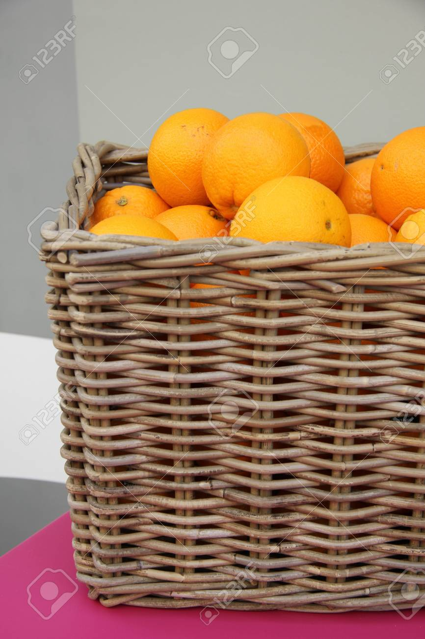 a wicker basket filled with juicy oranges Stock Photo - 15535727