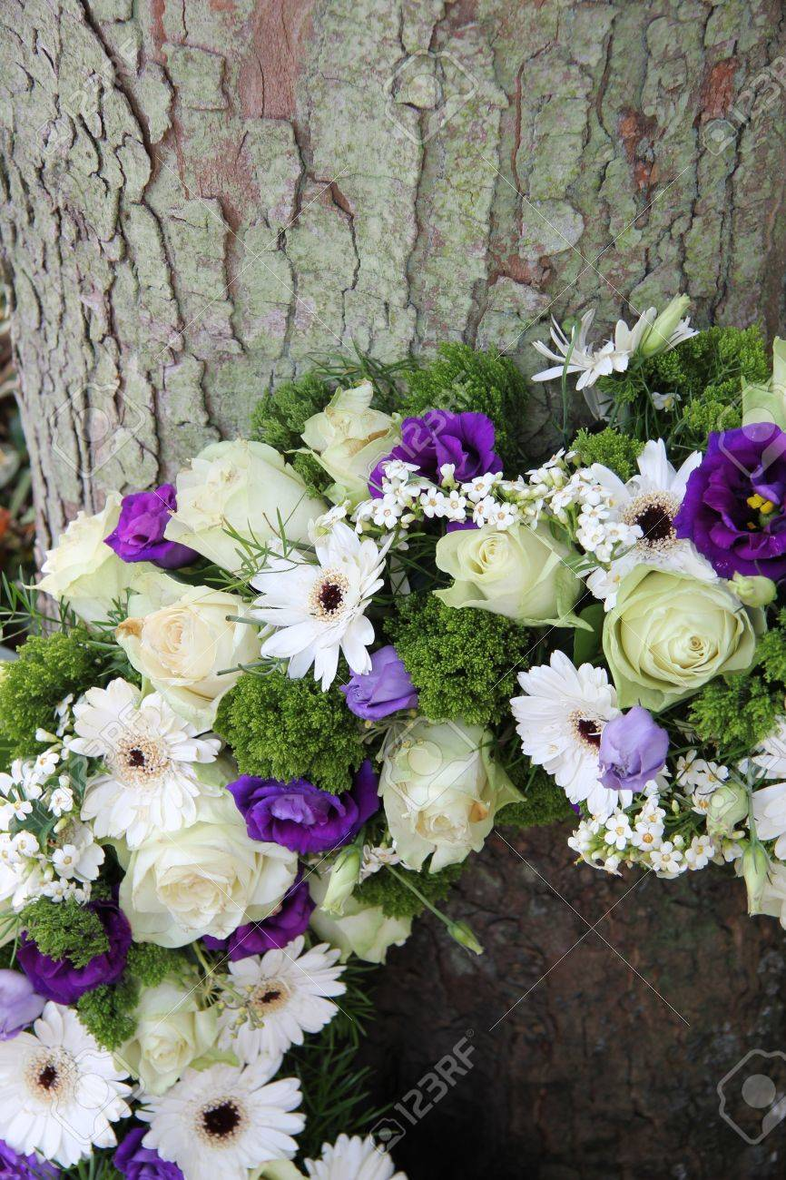 White And Purple Sympathy Flowers In A Funeral Wreathm Detail Stock