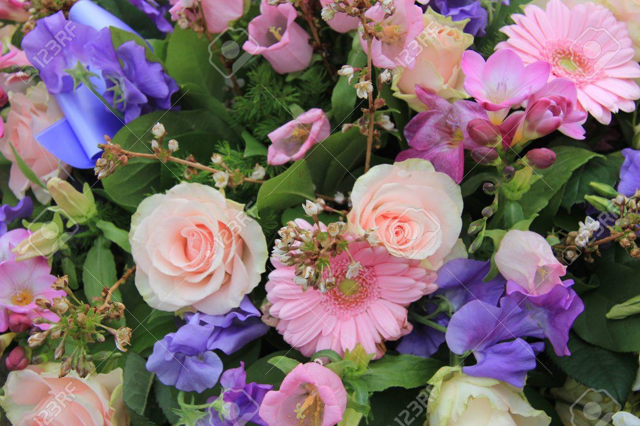 Various flowers in a mixed pink floral arrangement - 16000990