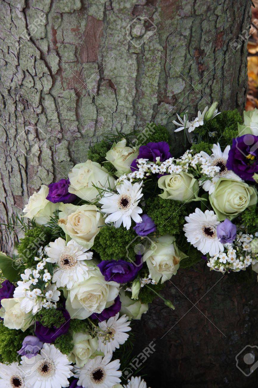 White And Purple Sympathy Flowers In A Funeral Wreath Detail Stock