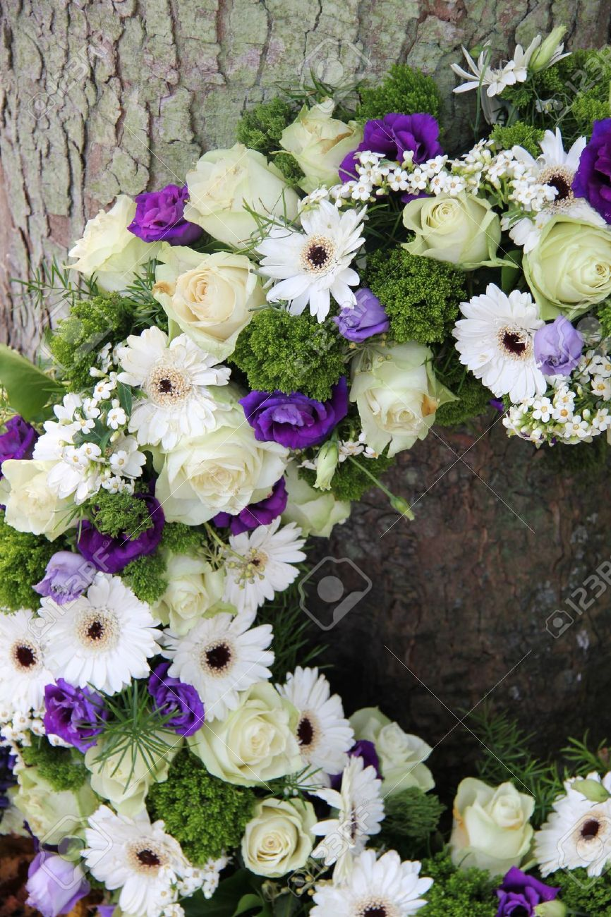 White and purple sympathy flowers in a funeral wreath, detail - 16186981