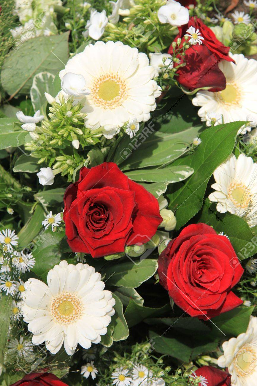 White Gerberas And Red Roses In A Flower Arrangement Stock Photo