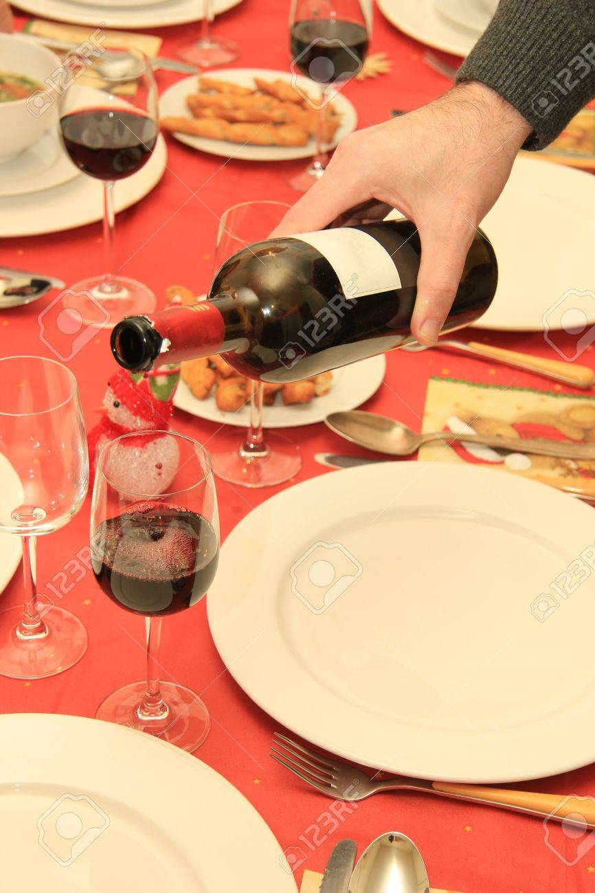 Man pouring red wine at a Christmas table Stock Photo - 17164272