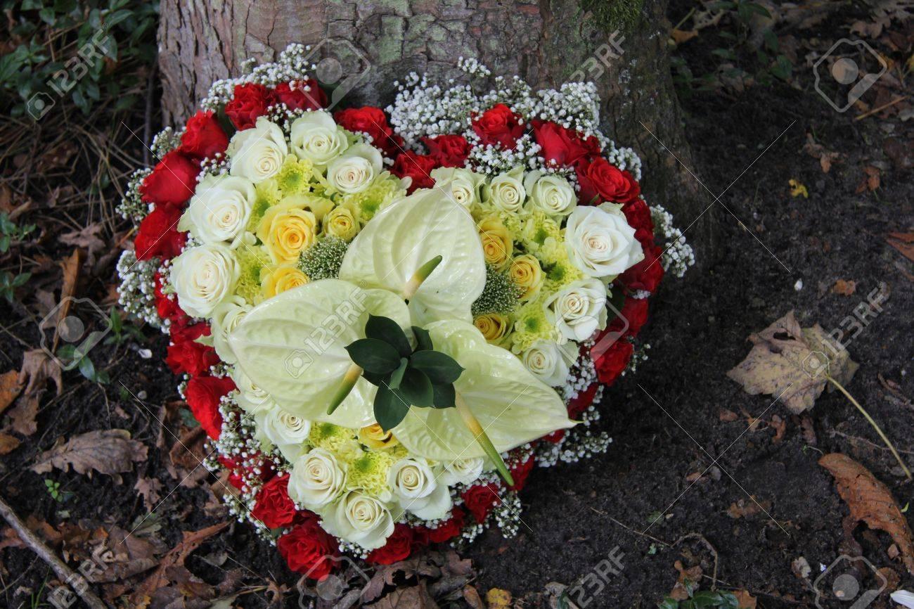 Floral arrangement for a funeral heart shaped with roses stock floral arrangement for a funeral heart shaped with roses stock photo 17204505 izmirmasajfo