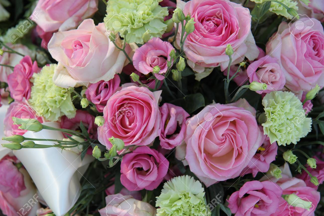 Pink Roses And Green White Carnations In A Bridal Flower Arrangement