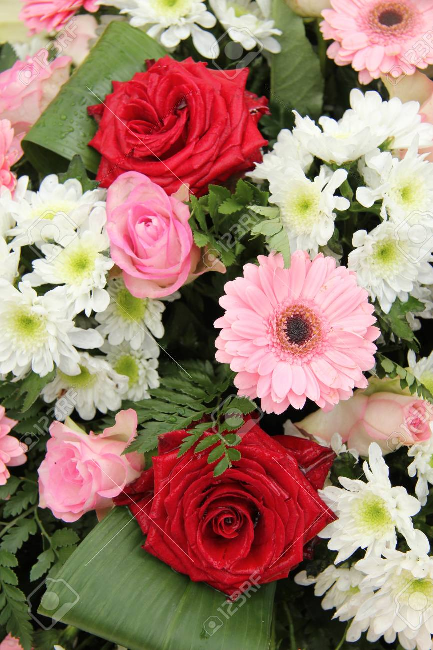 Red Roses And Pink Gerberas In A Mixed Wedding Centerpiece Stock ...