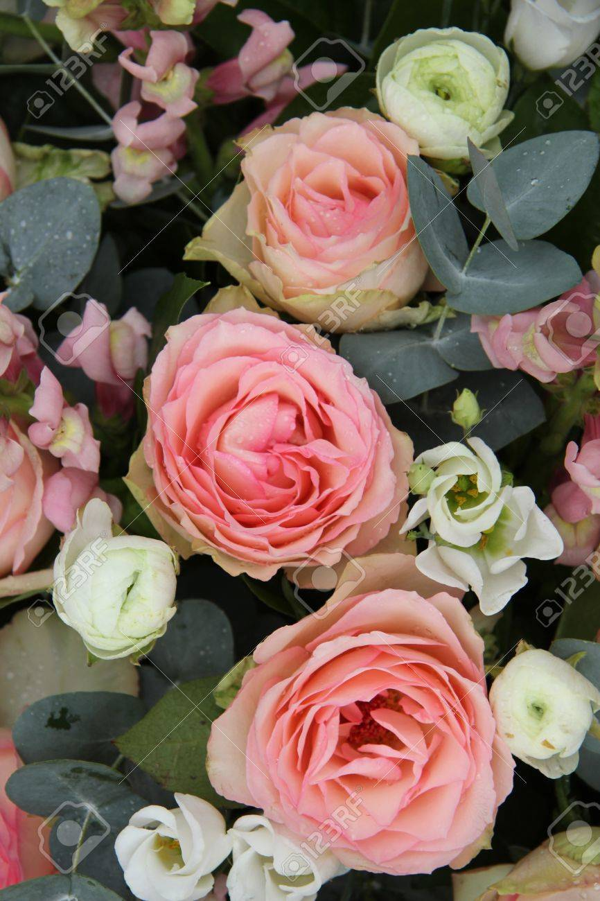 Pink Roses And Eucalyptus In A Pink White Wedding Flower Arrangement