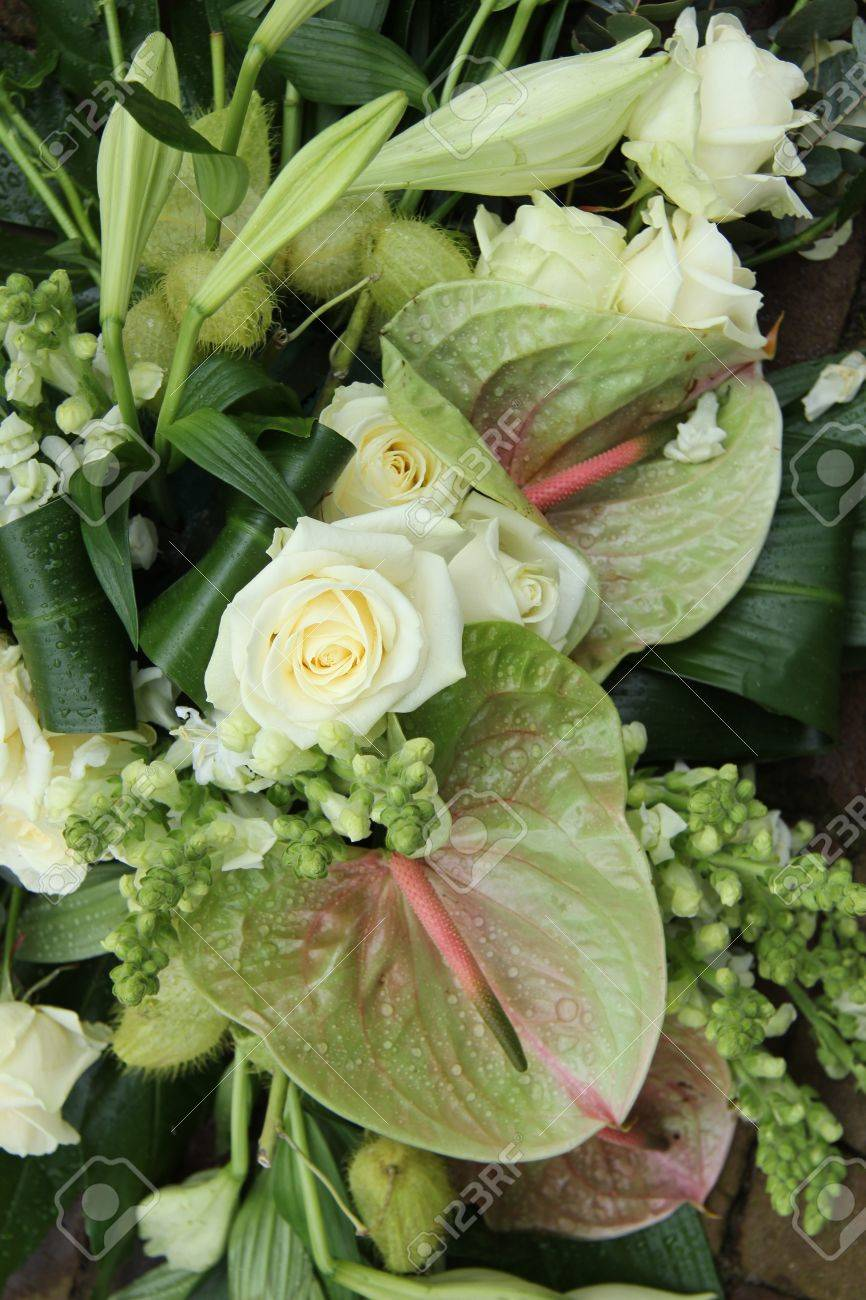 Soft Green Anthurium And White Roses In A Flower Arrangement Stock