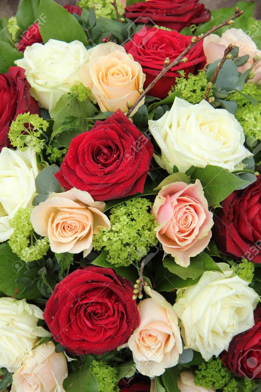 Bridal flower arrangement in red pink and white big roses stock bridal flower arrangement in red pink and white big roses stock photo 19224932 mightylinksfo