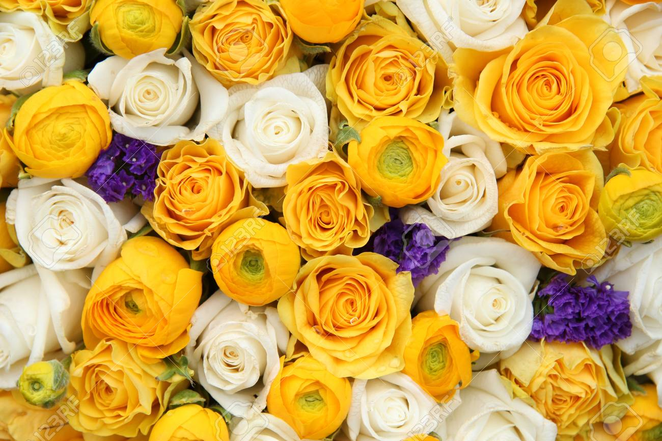 Wedding Flowers In Yellow And White With A Touch Of Purple Stock