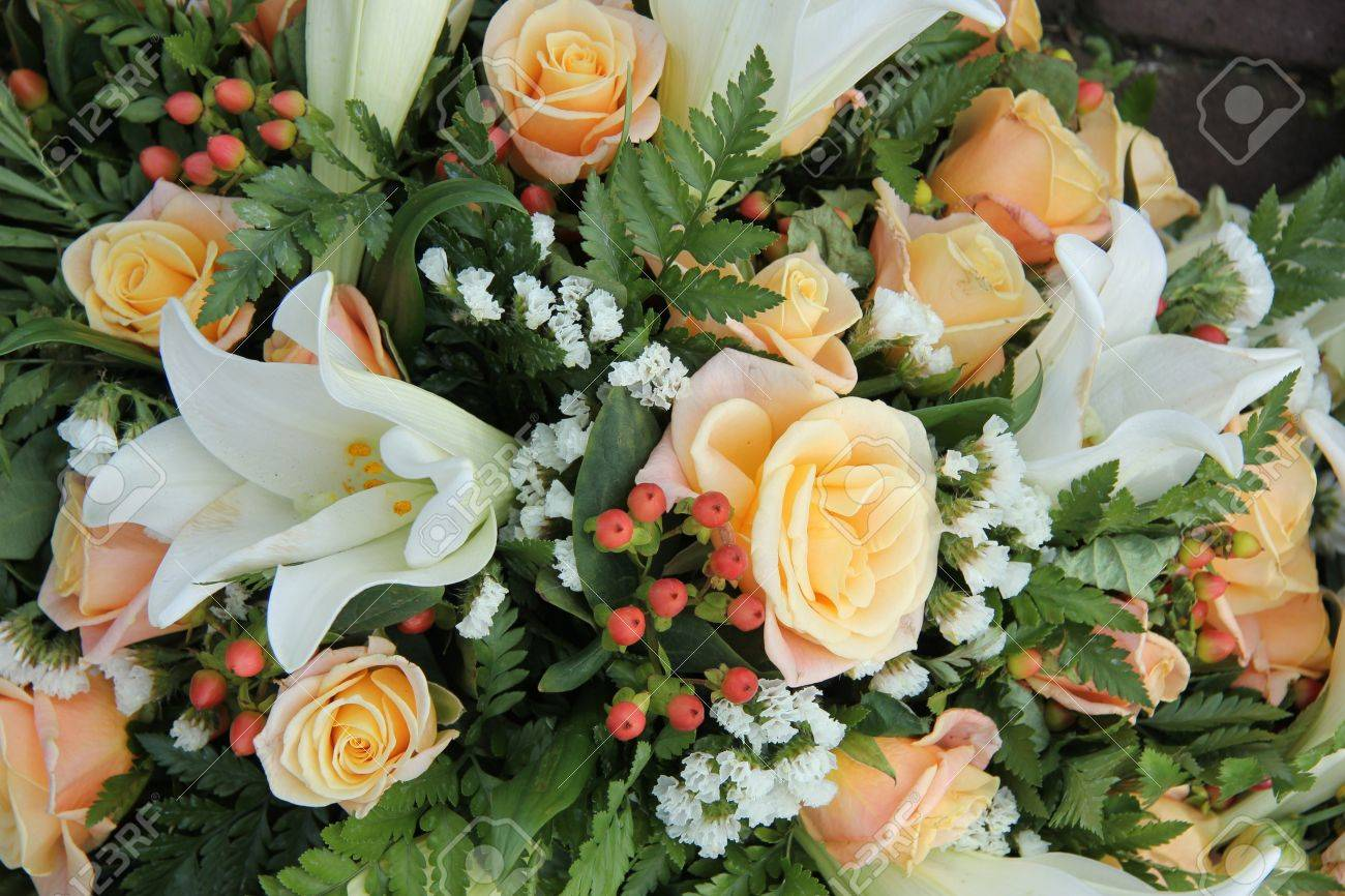 White Tiger Lillies And Yellow Pink Roses In A Bridal Bouquet Stock