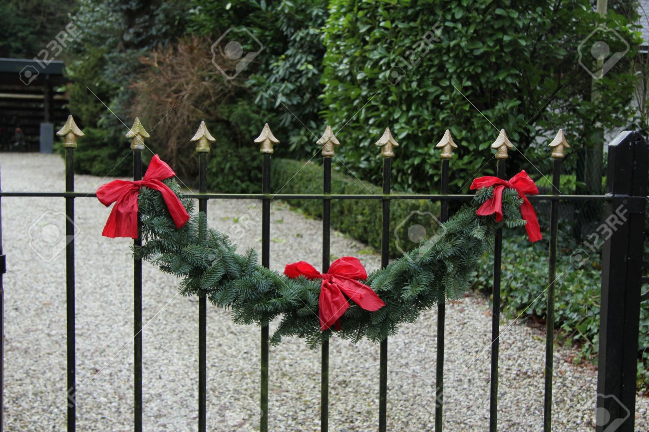 Classic steel fence decorated with a traditional christmas garland Stock  Photo - 19828253