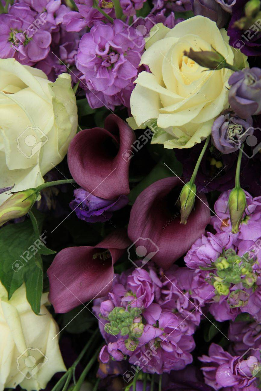 Wedding Flower Arrangement In White And Purple Roses And Calla