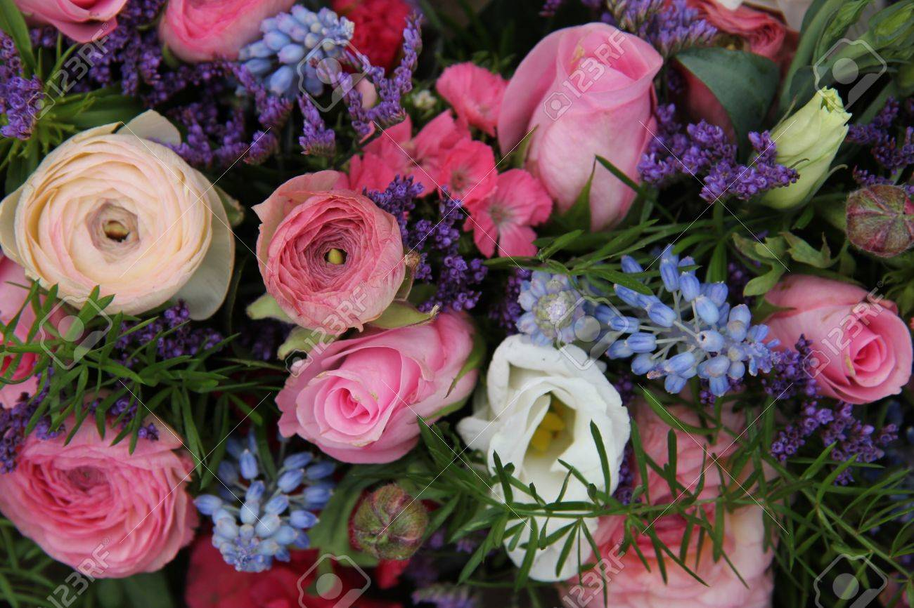 Pink Roses And Ranonkels Blue Common Hyacints In A Spring Flower Wedding Centerpiece Stock Photo