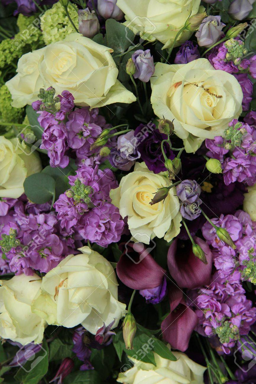 wedding flower arrangement in white and purple, roses and calla, Beautiful flower