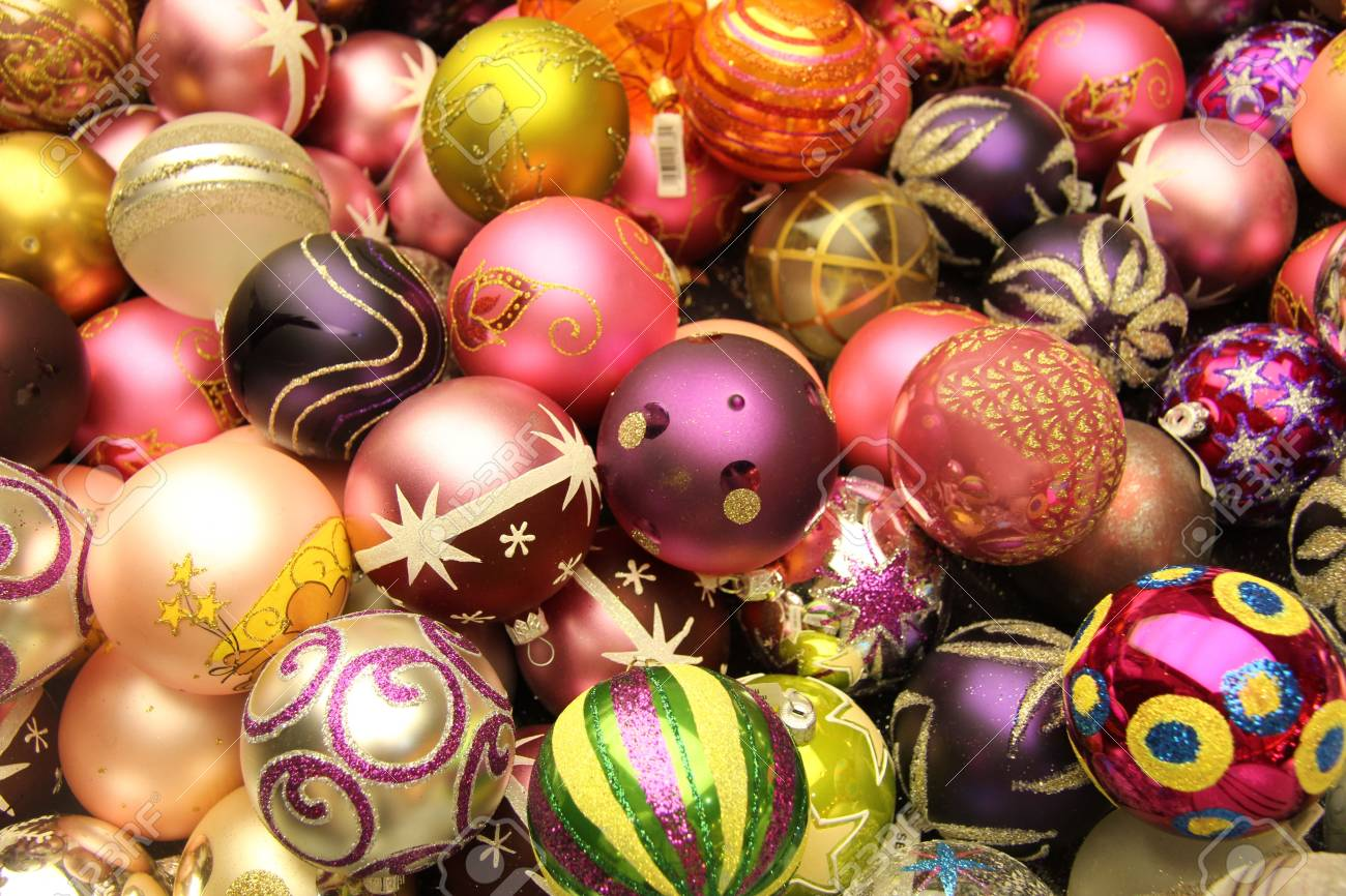 Pile Of Glass Handpainted Christmas Ornaments In Various Colors
