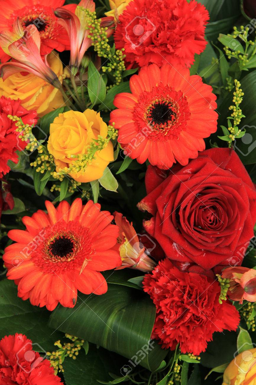 Wedding Decorations In Red Orange And Yellow Gerberas Carnations