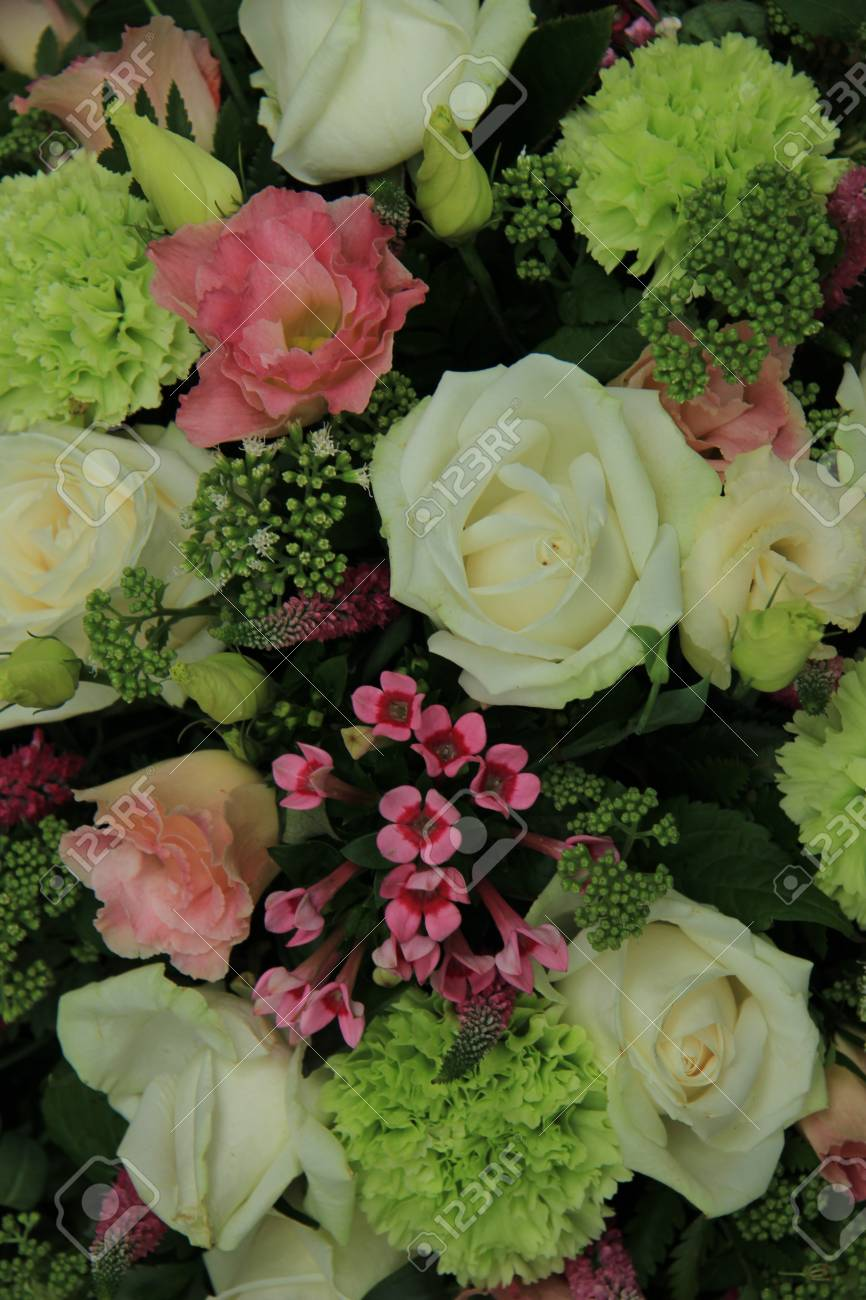 White Roses And Several Pink Flowers In A Bridal Flower Arrangement