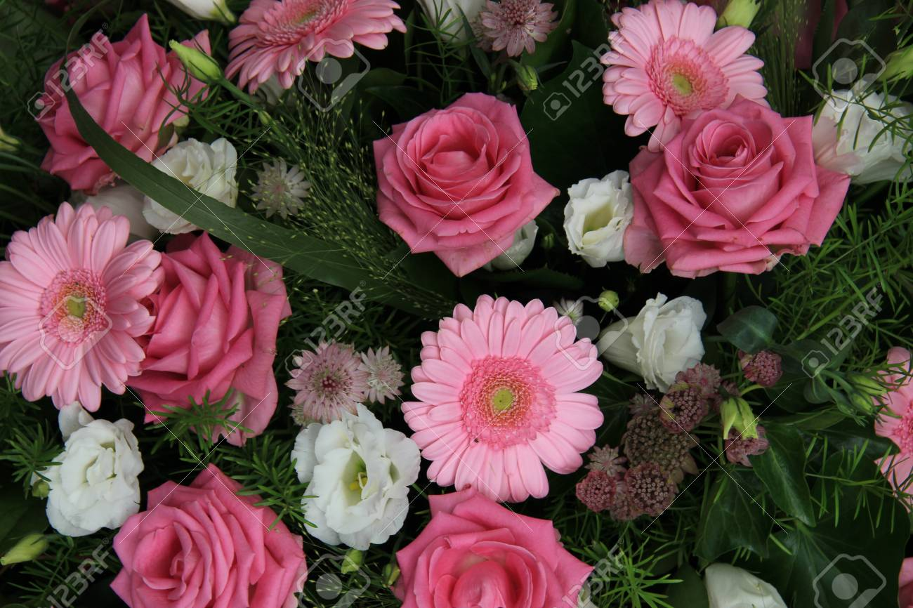 Gerberas And Roses In A Pink Wedding Flower Arrangement Stock Photo ...