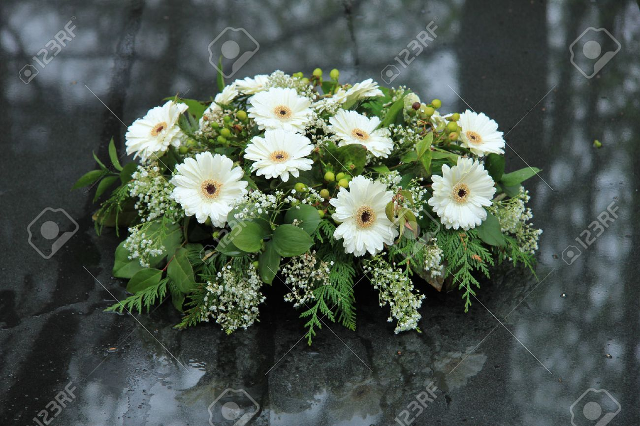 Funeral flowers images stock pictures royalty free funeral funeral flowers white funeral flowers on a grey marble tomb dhlflorist Gallery