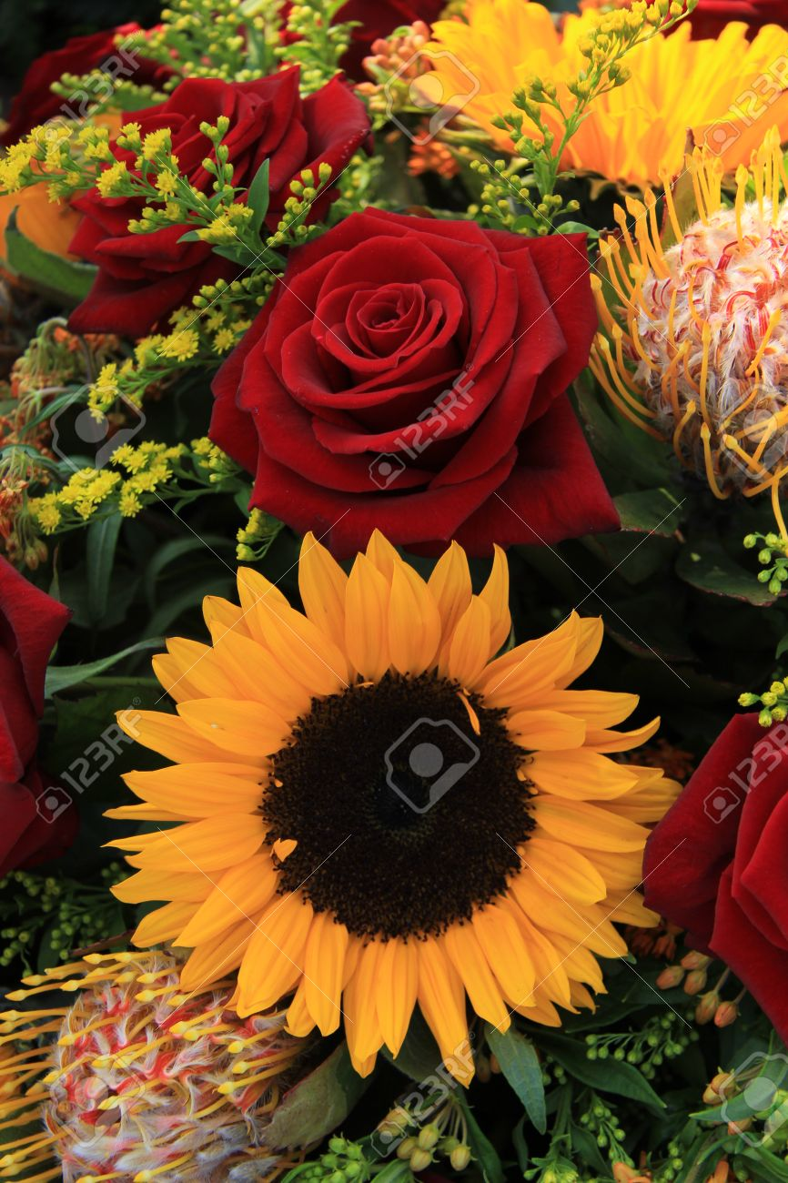 Sunflowers And Big Red Roses In A Wedding Arrangement Stock Photo