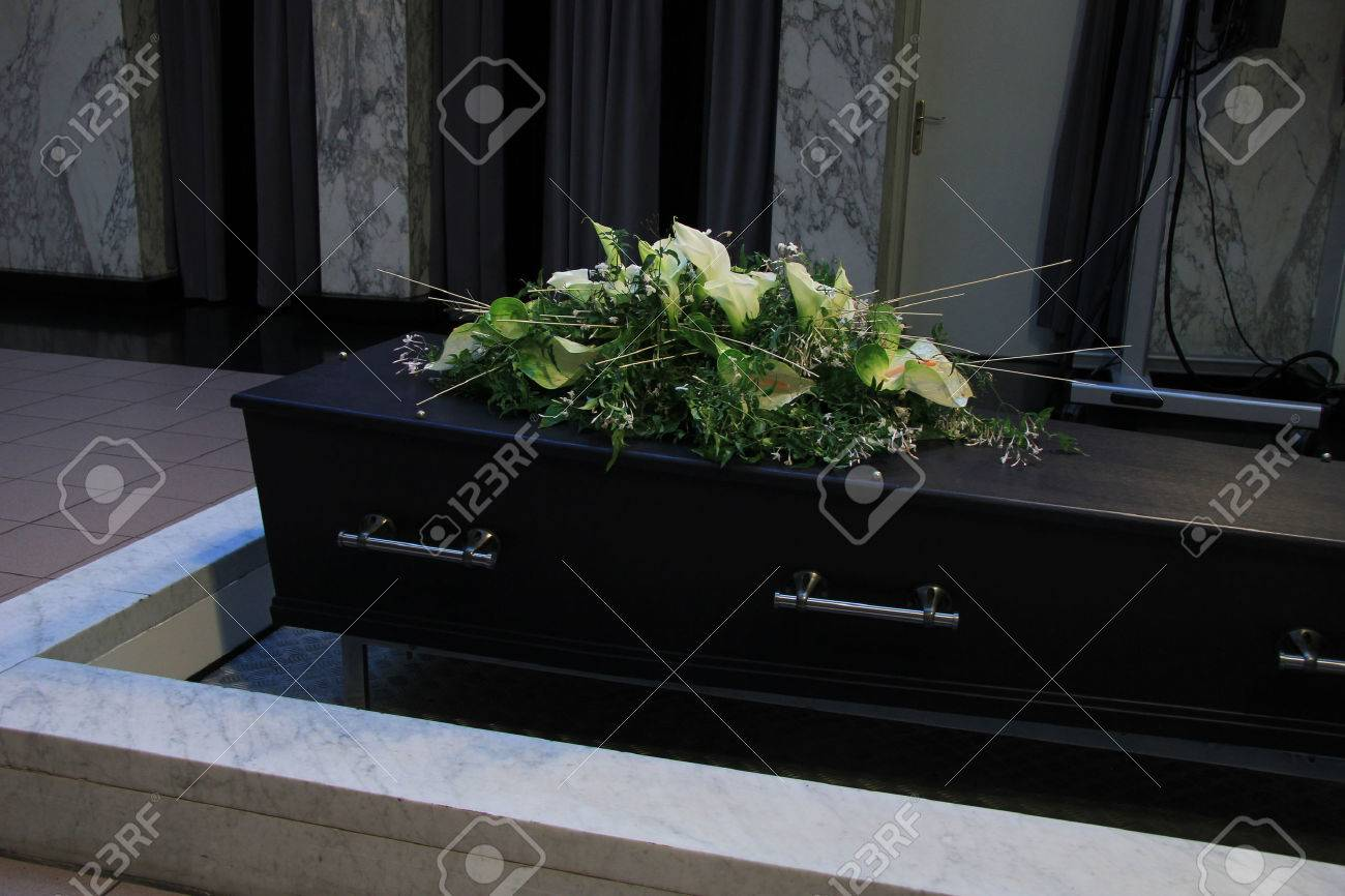 Funeral flowers on a casket, funeral service - 28513006