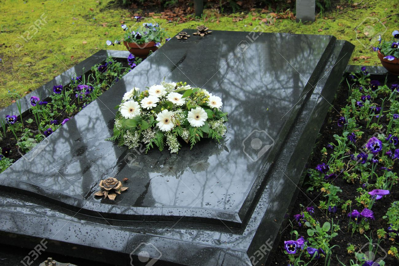 Sympathy flowers stock photos pictures royalty free sympathy sympathy flowers white funeral flowers on a grey marble tomb dhlflorist Choice Image