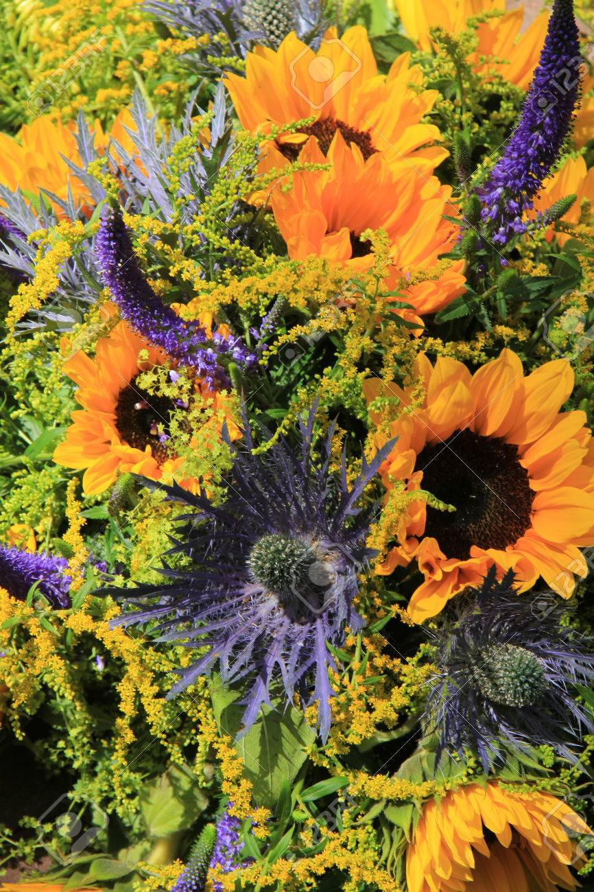 Blue And Yellow Wedding Flowers Sunflowers And Eryngium Or Sea