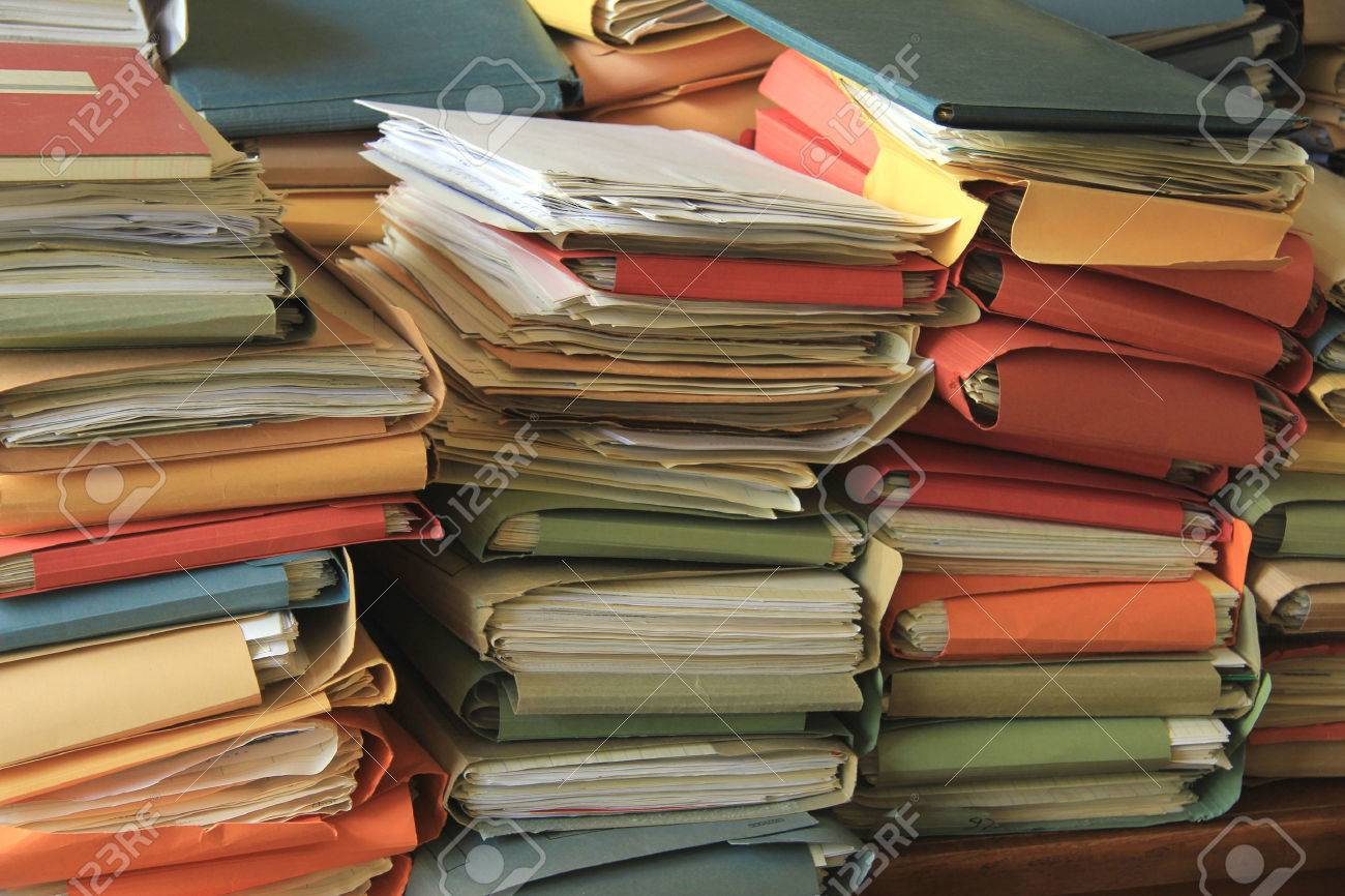 Stacked office files: pile of paperwork in an office - 30448479