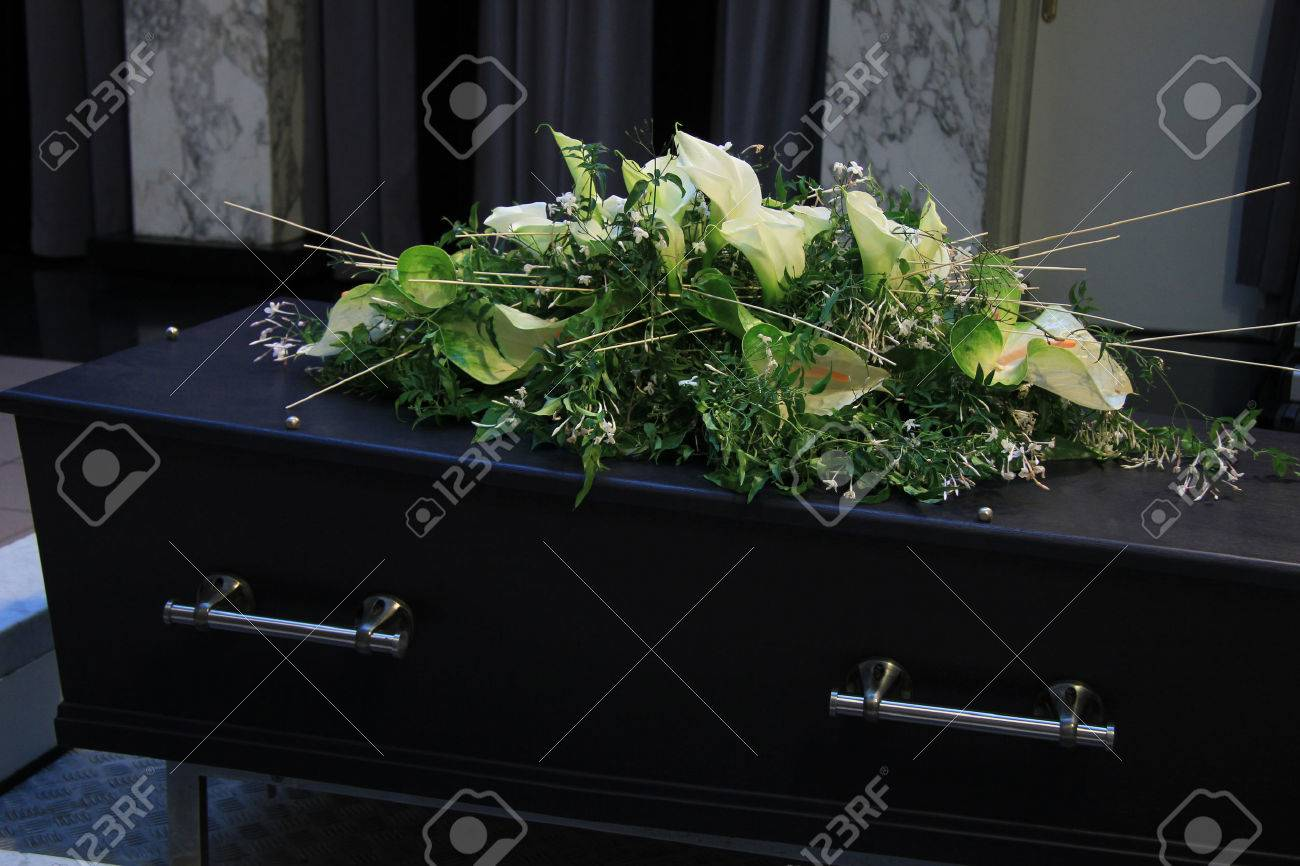 Funeral flowers on a casket, funeral service - 39782339