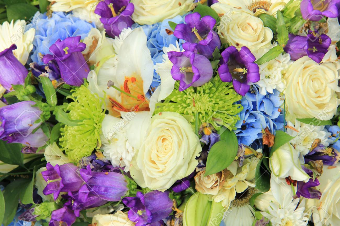 stock photo white roses and blue purple flowers in a wedding flower arrangement