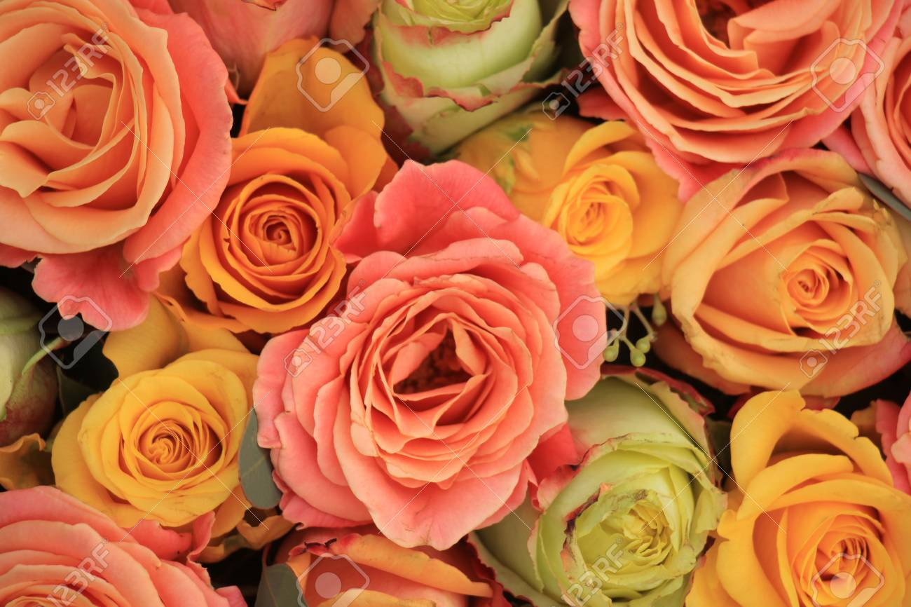 Yellow Orange And Pink Roses In A Floral Arrangement At A Wedding Stock Photo Picture And Royalty Free Image Image 50695448