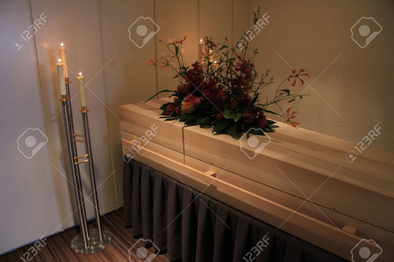 Wooden casket - contemporary style - in a funeral home - 53922553