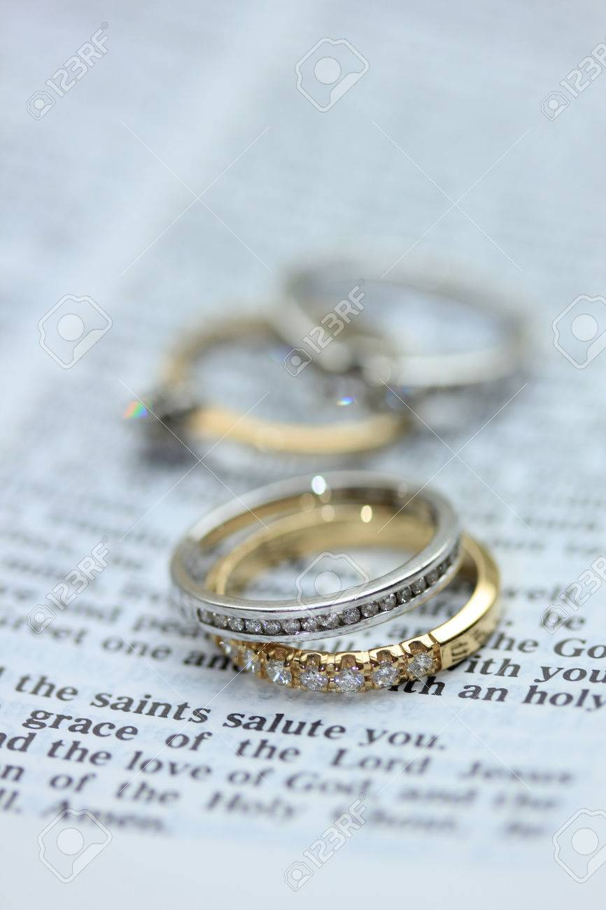 Two Diamond Wedding Bands For A Double Bride Wedding On A Bible
