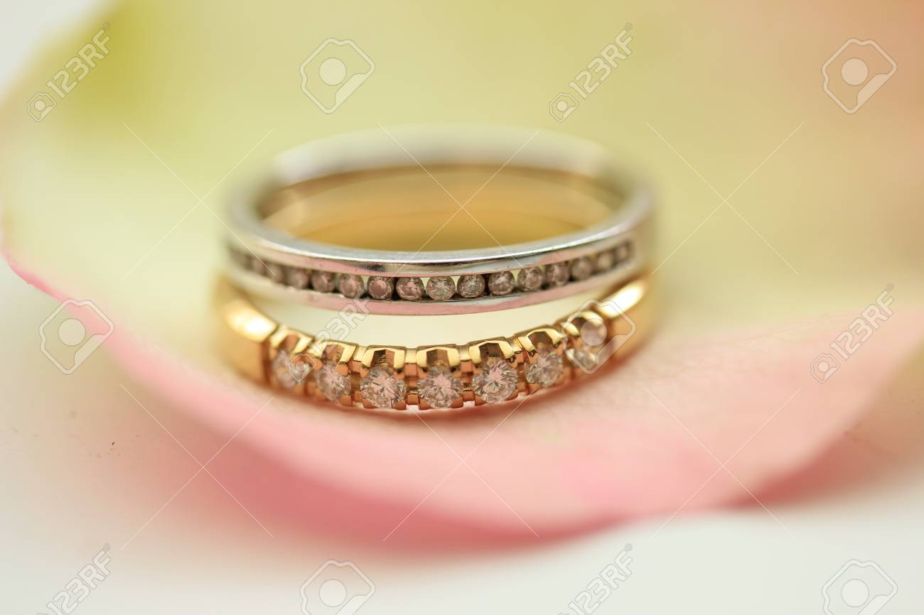 Two Diamond Wedding Bands On A Rose Petal Stock Photo Picture And