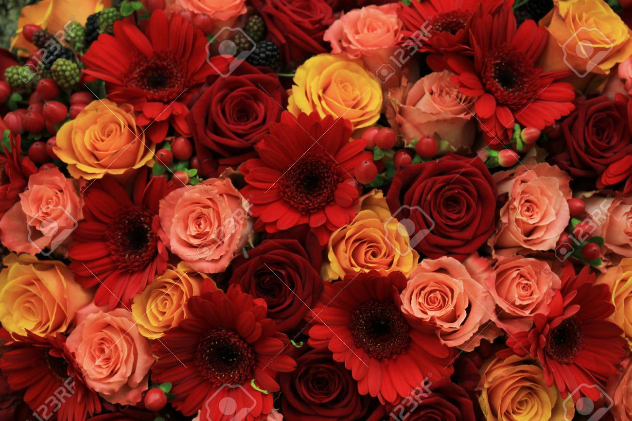 Mixed Rose Wedding Arrangment In Red Pink Orange And Yellow Stock