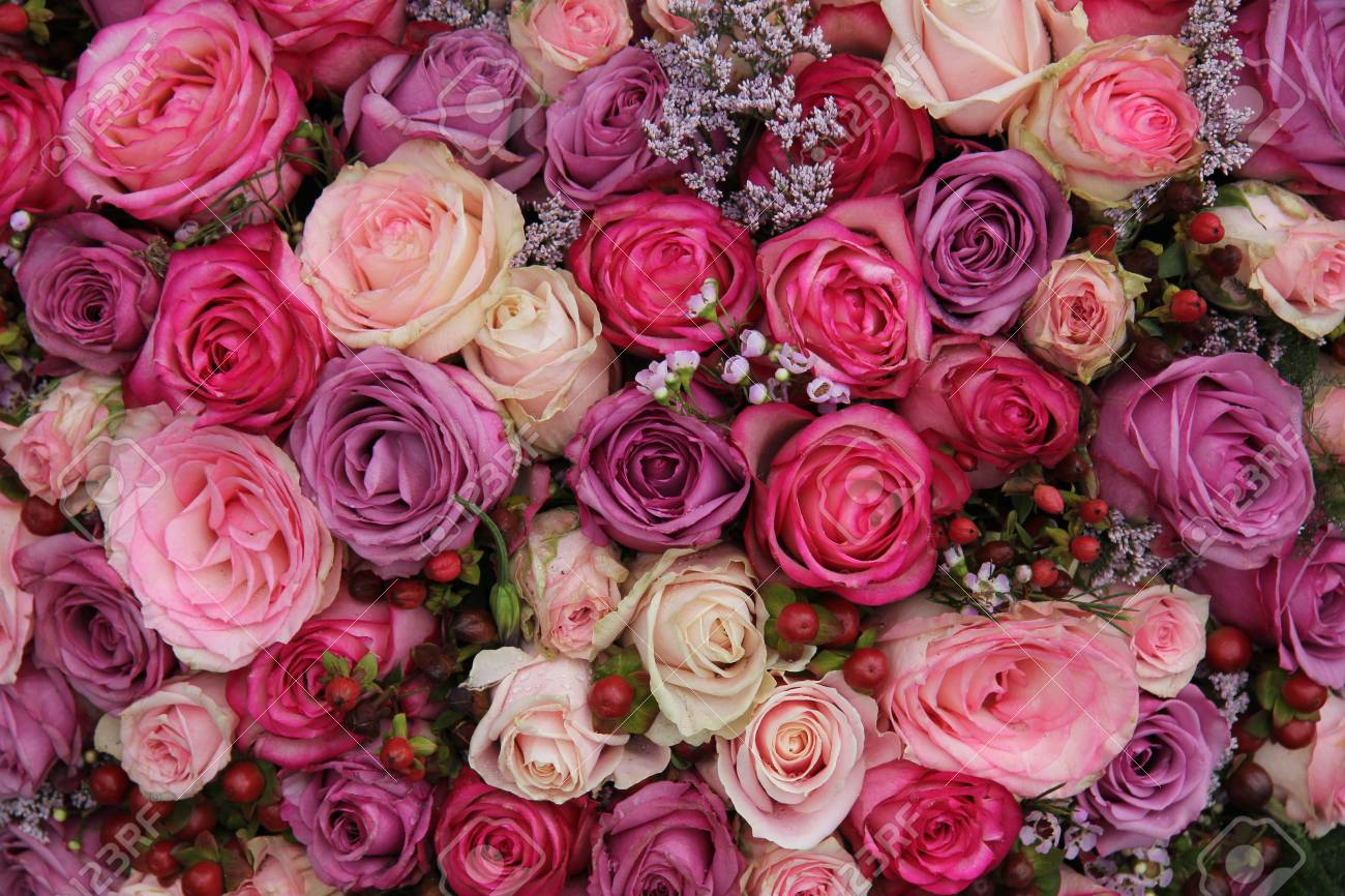 Pink And Purple Roses In A Wedding Flower Arrangement Stock Photo