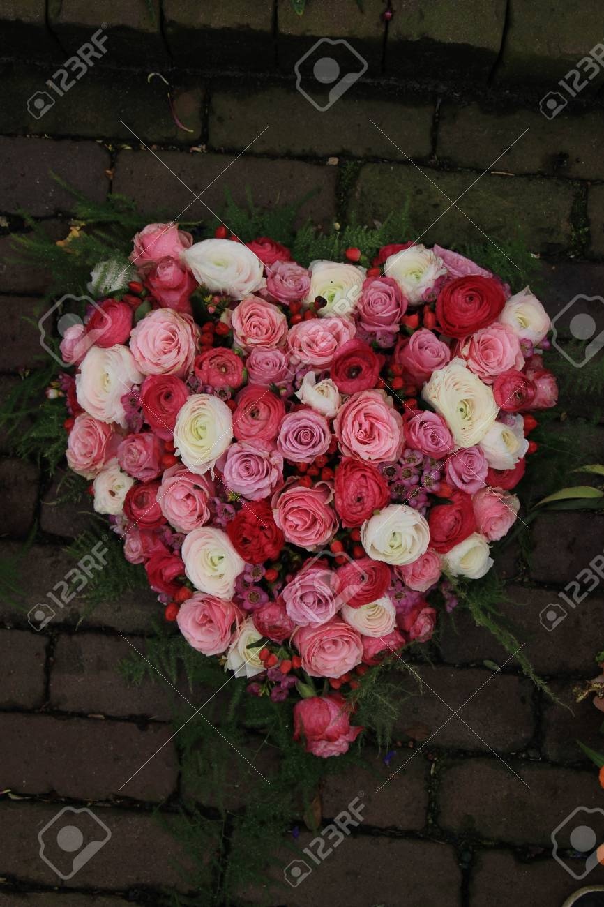 Heartshaped sympathy flowers or funeral flowers near a tree stock heartshaped sympathy flowers or funeral flowers near a tree stock photo 75187455 izmirmasajfo