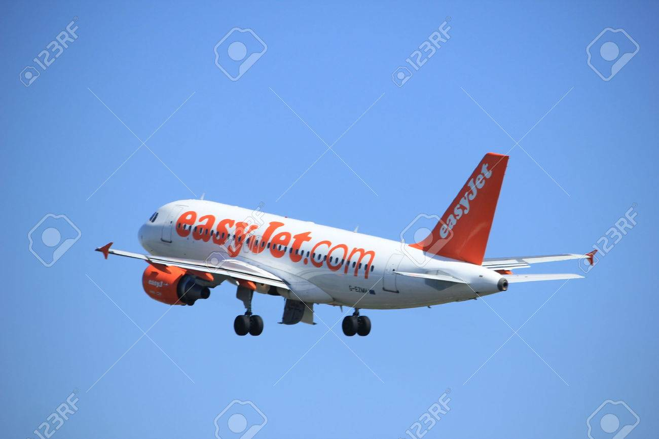 Amsterdam the Netherlands - April 2nd, 2017: G-EZMH easyJet Airbus A319-100 takeoff from Polderbaan runway, Amsterdam Airport Schiphol - 75805819