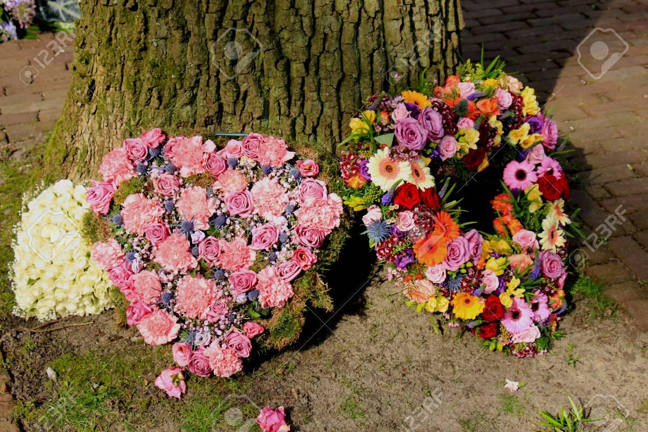 Heartshaped sympathy flowers or funeral flowers near a tree stock heartshaped sympathy flowers or funeral flowers near a tree stock photo 76162284 izmirmasajfo