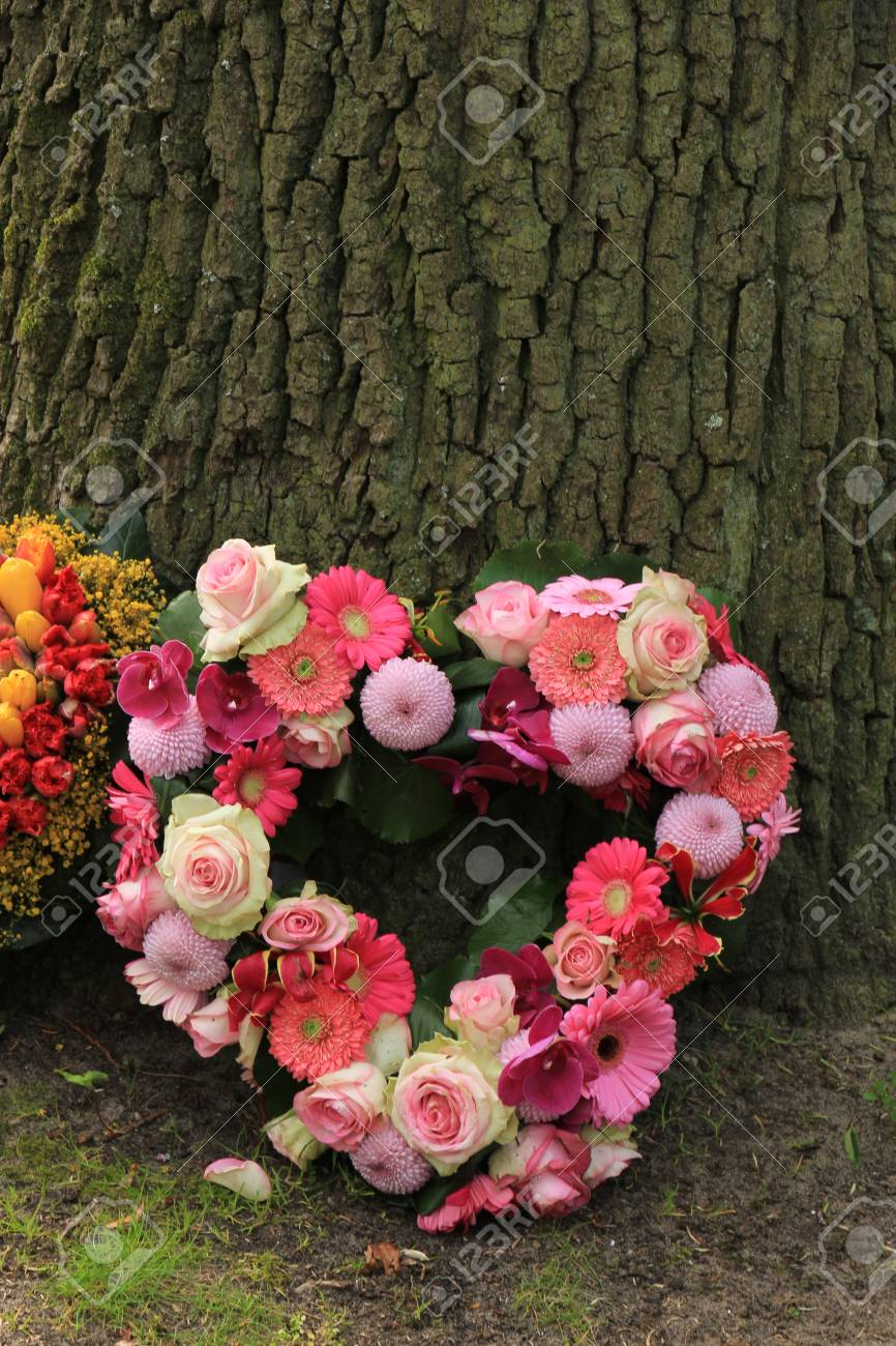 Heartshaped Sympathy Flowers Or Funeral Flowers Near A Tree Stock