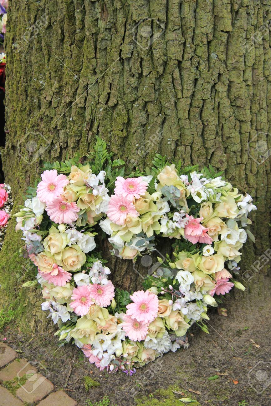 Heart shaped sympathy flowers or funeral flowers near a tree stock heart shaped sympathy flowers or funeral flowers near a tree stock photo 82107759 izmirmasajfo