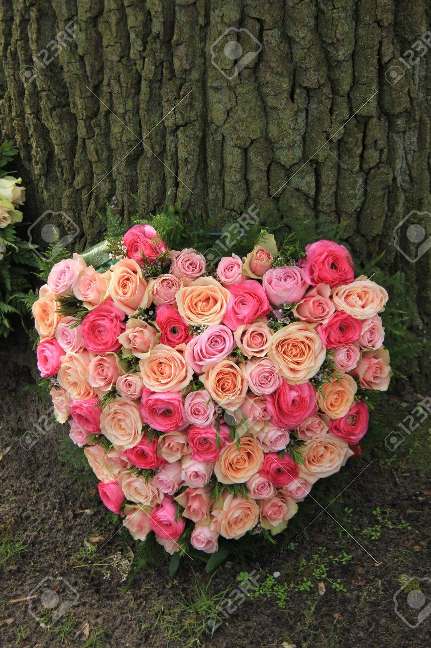 Heart shaped sympathy flowers or funeral flowers near a tree stock heart shaped sympathy flowers or funeral flowers near a tree stock photo 82104687 izmirmasajfo