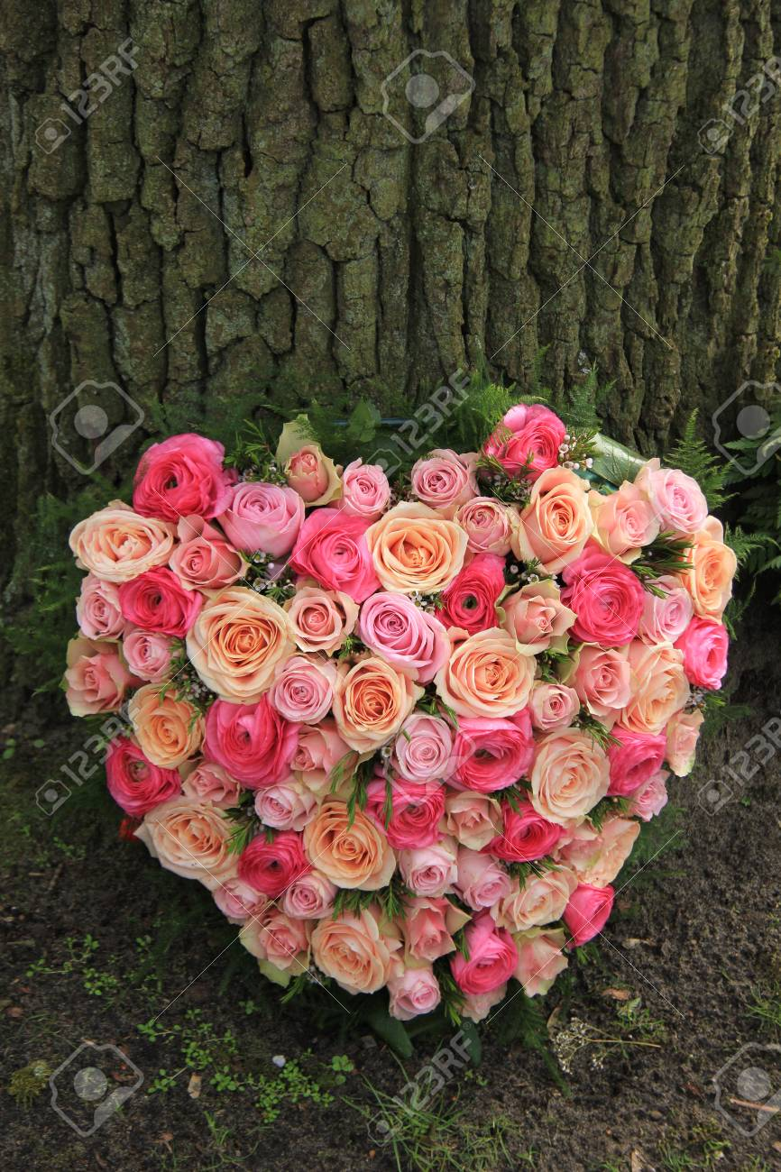 Heart shaped sympathy flowers or funeral flowers near a tree stock heart shaped sympathy flowers or funeral flowers near a tree stock photo 82967180 izmirmasajfo Gallery