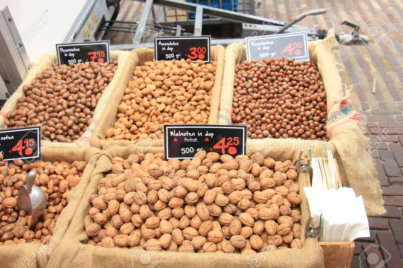 Fresh unpealed nuts on a market stall (text on tags: names and