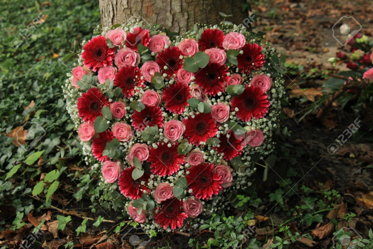 Heart Shaped Sympathy Flowers Or Funeral Flowers Near A Tree