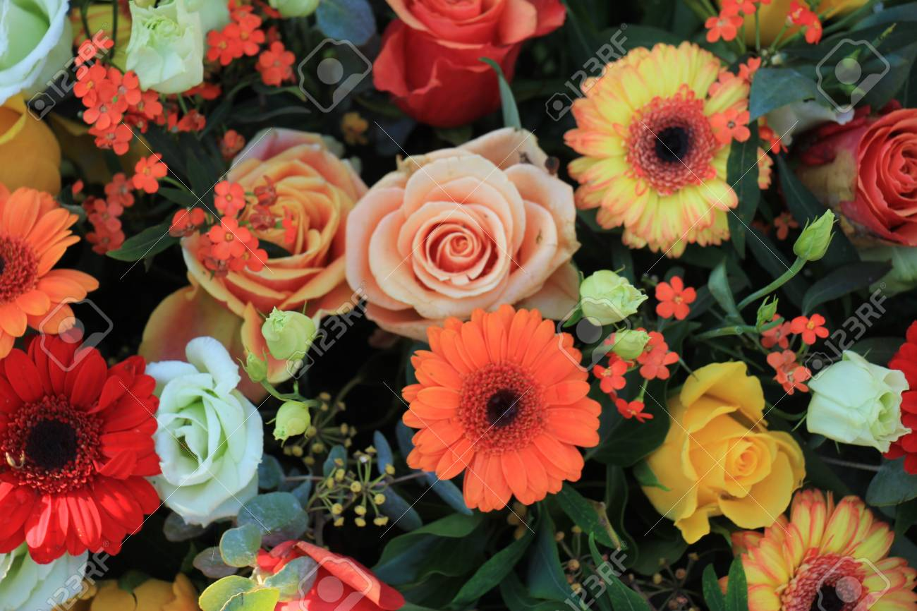 Flower Arrangement For A Wedding In Yellow Pink And Orange Stock