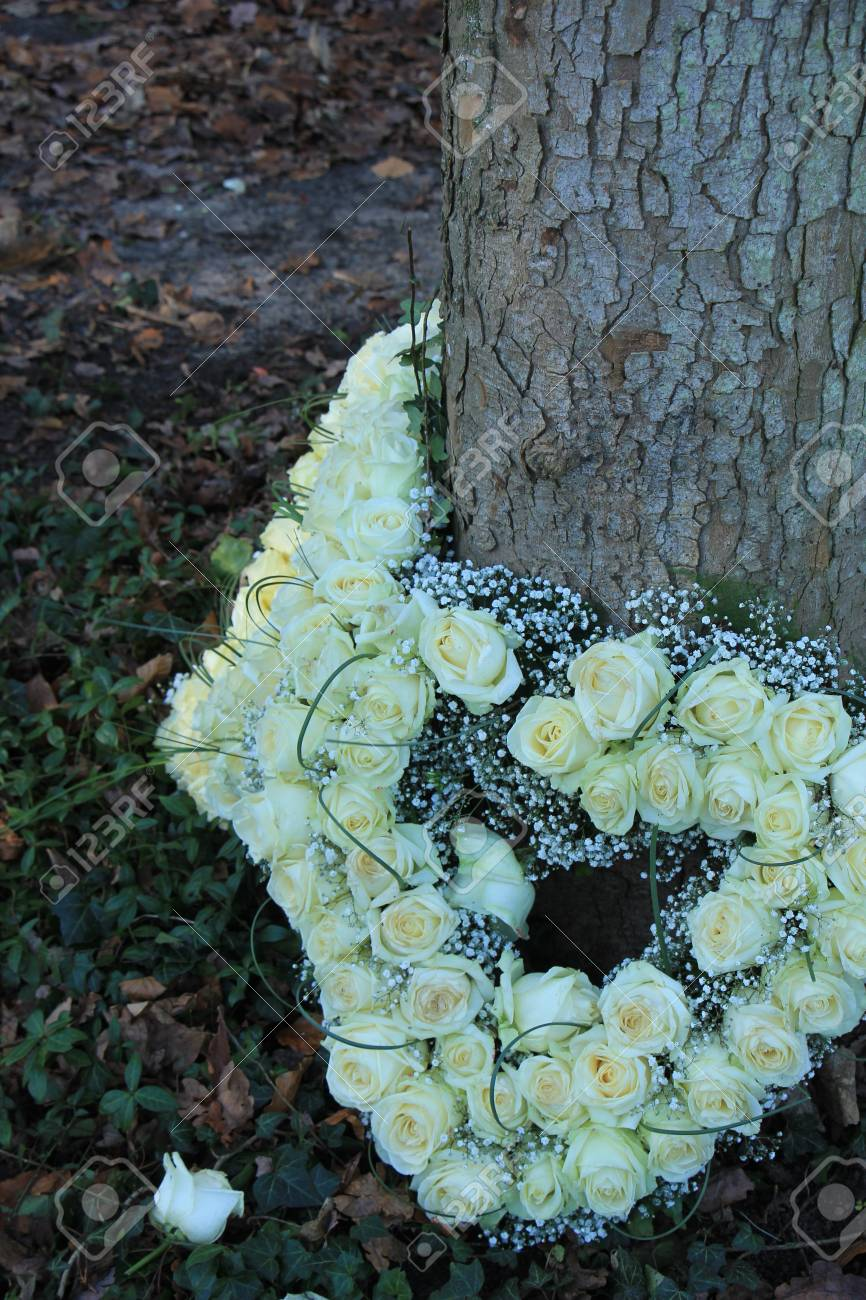 Heartshaped sympathy flowers or funeral flowers near a tree stock heartshaped sympathy flowers or funeral flowers near a tree stock photo 93711132 izmirmasajfo
